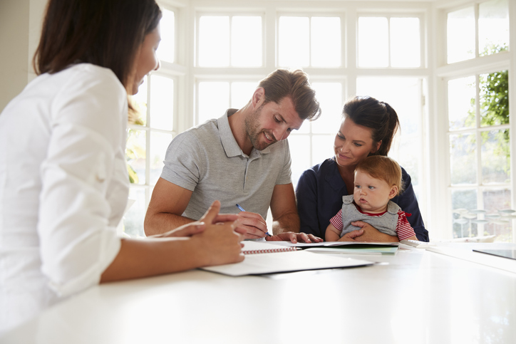 Personal-family-financial-strategies-family-signing-ducment